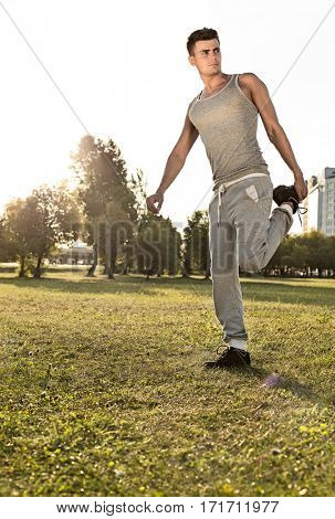 Full length of young man exercising in park