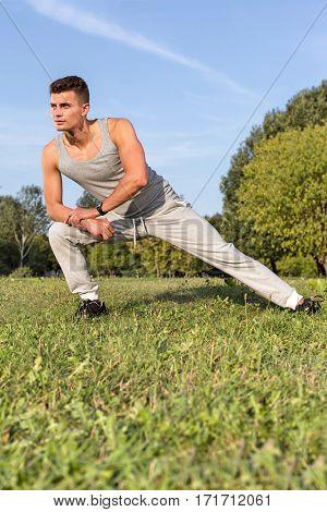 Full length of determined man exercising in park