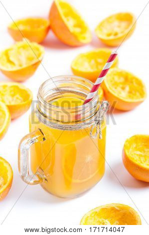 Orange juice in glass isolated on white background