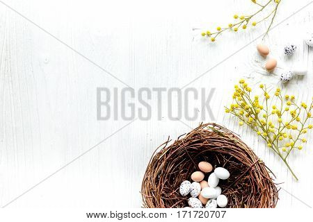 Eggs and nest set for easter celebration on white background top veiw mock-up