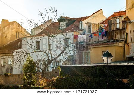 Houses with clothes hanging outside to dry, by the park below the viewpoint of graca