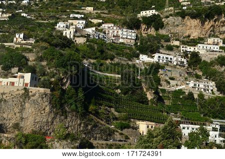 Italy's Amalfi Coast with terraced homes on the cliffs.