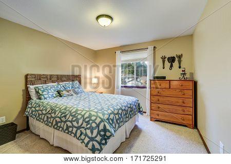 Restful Bedroom Boasts A Wicker Headboard