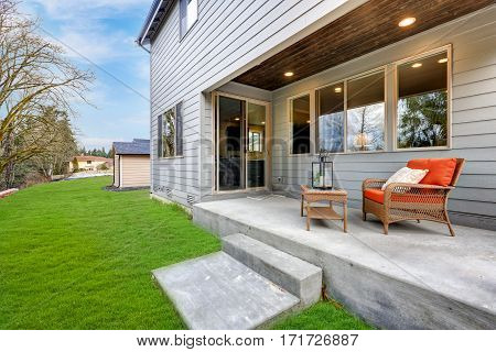 Covered Back Porch With Concrete Floor And Stairs