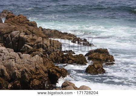 This is an image of the rocky shoreline of Point Lobos State Preserve in Carmel, California, USA.