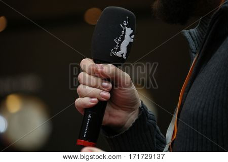 Microphone attends the 'The Bar' (El Bar) press conference during the 67th Berlinale Film Festival Berlin at Grand Hyatt Hotel on February 15, 2017 in Berlin, Germany.