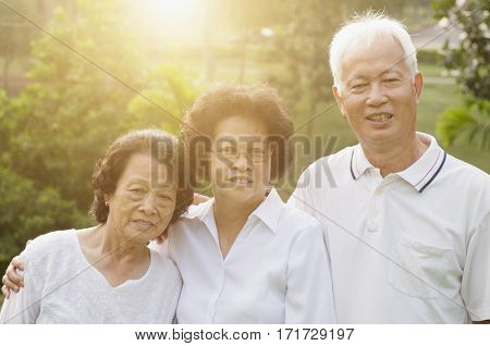 Portrait group of healthy Asian seniors having activities at outdoor nature park, in morning beautiful sunlight at background.