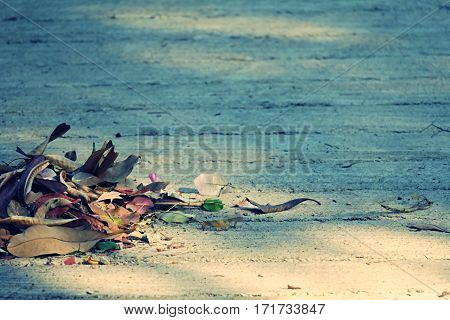 Pile of dry leaves falling on floor and sunshine shadow abstract background