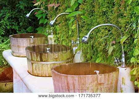Outdoor wooden wash basins in the garden and abstract background