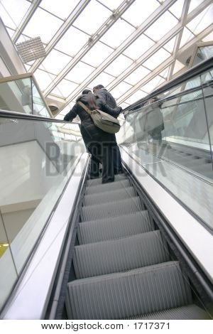 Couple On An Escalator