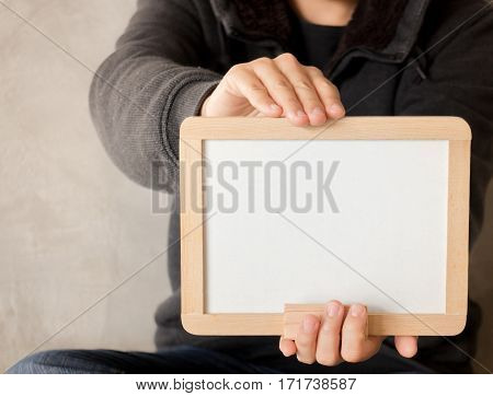 Woman holding a blank whiteboard stock photo