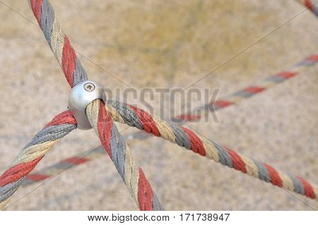 Iron jointed point of ropes in children spider web, use a symbol for teamwork, harmony, rapport or collaboration,outdoor equipment.