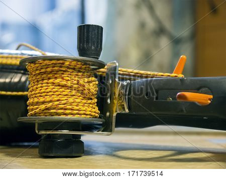The coil rope on the spear gun