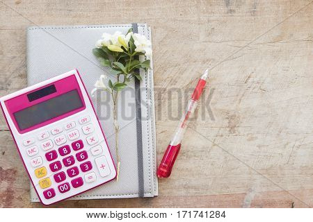 notebook monthly planner record for financial on office desk