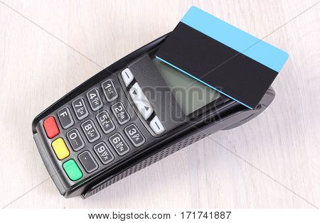 Payment Terminal With Contactless Credit Card On Wooden Background, Cashless Paying For Shopping Or