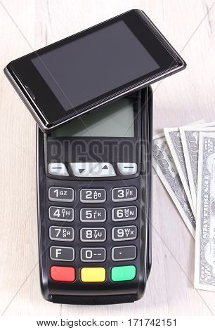 Payment Terminal With Mobile Phone With Nfc Technology And Currencies Dollar, Cashless Paying For Sh