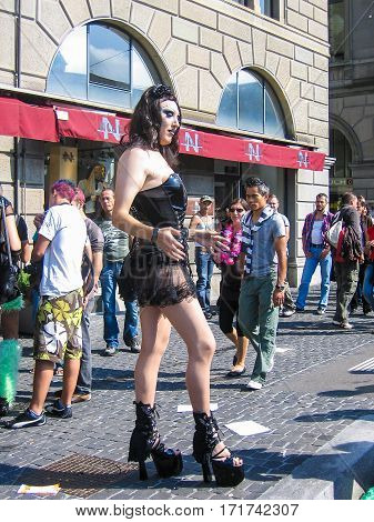 Zurich, Switzerland - August 11, 2008: Techno parade with transgender drag queen woman in high heels