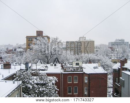 Cityscape or skyline of Washington DC Dupont Circle apartment buildings in winter snow