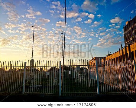Weather station equipment at sunset in the summer