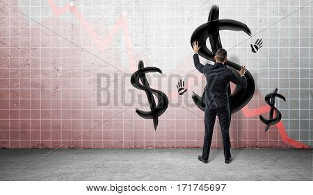 Businessmen on statistical chart background placing hands on a wall with black painted dollar signs and hand prints. Business and finance. Oil and gas industry. Money and banking.
