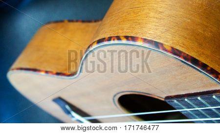 Close up side curve of a classical guitar