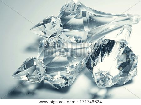 accessories, small transparent crystals, over white background
