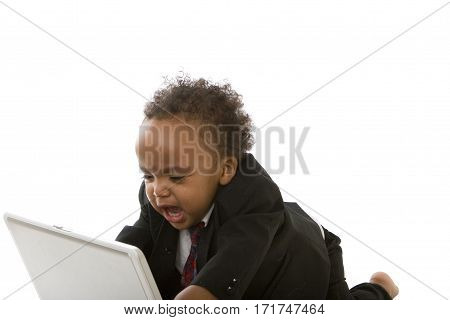 Crying African American little boy surfing the internet.