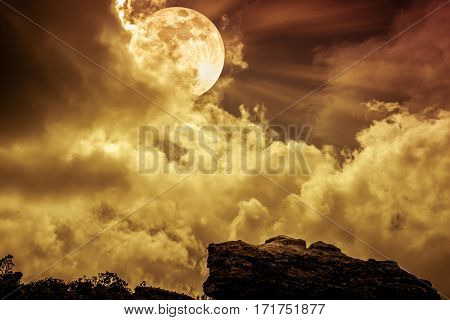 Boulder Against Sky With Clouds And Beautiful Full Moon. Outdoors. Sepia Tone.