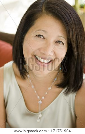 Mature Confident Well Dressed Asian Businesswoman Smiling