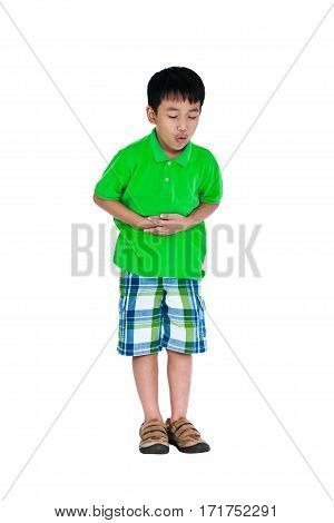 Full body of unhappy asian child suffering from stomachache his hand on belly. Isolated on white background. Studio shot. Human healthcare and problem concept.
