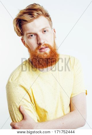 young handsome hipster ginger bearded guy looking brutal isolated on white background, lifestyle people concept close up
