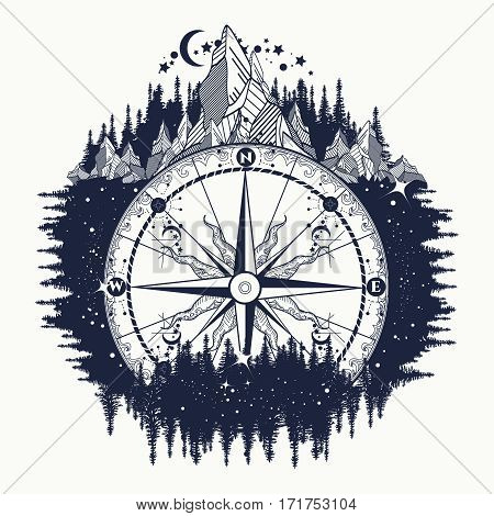 Mountain antique compass and wind rose tattoo art. Adventure travel outdoors symbol. Tattoo for travelers climbers hikers. Compass in the night forest tattoo boho style t-shirt design