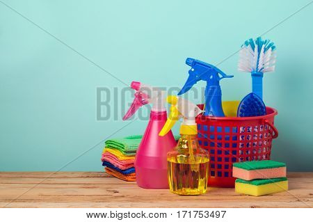 Cleaning concept with supplles over mint background