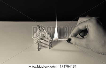 Matches house and hand with burning fire - risk of accident at night