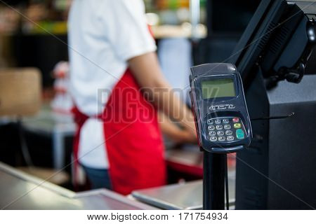 Credit card terminal at cash counter in supermarket