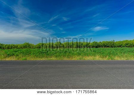 Asphalt road and countryside views with blue sky