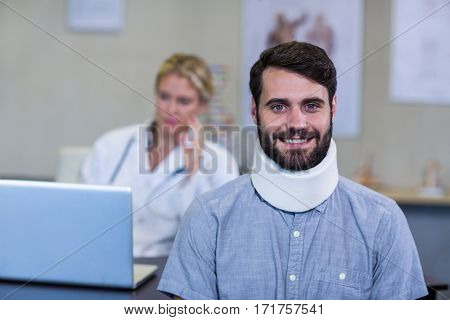 Portrait of patient with a cervical collar in clinic