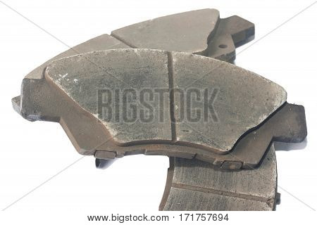 Old brake pads disk brake, isolated on a white background