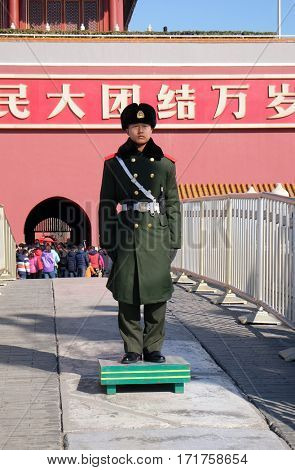 BEIJING, CHINA - FEBRUARY 23, 2016: Honor guard soldier before Entrance of Gate of Heavenly Peace, Imperial Palace on Tiananmen Square. Forbidden city on February 23, 2016.