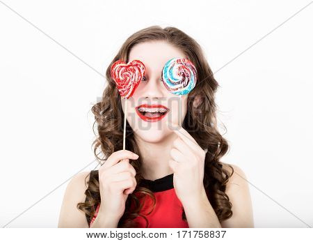 portrait of young beautiful woman with dental braces and sugarplum glasses.