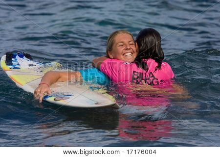MAUI, HAWAII - DECEMBER 18, 2008:     Professional surfer Stephanie Gilmore hugs Layne Beachley after their heat during the Billabong Pro Maui - December 18, 2008 Maui, HI.