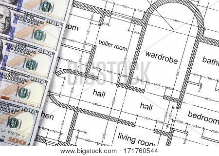 Banknotes in one hundred dollars, financial prosperity, dollars on construction drawings, space for design, money close-up, investment in real estate