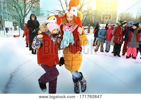 School Kids Celebrate Maslenitsa. Cockfight Game