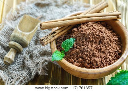 Cocoa Powder And Cinnamon In A Wooden Bowl.