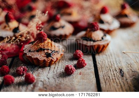 Delicious Chocolate Cupcakes With Berries On Wodeen Table, Top V