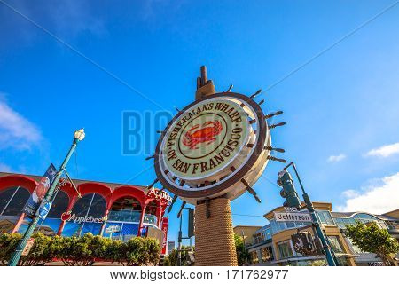 San Francisco, California, United States - August 14, 2016: signboard of Fisherman's Wharf waterfront of San Francisco on Jefferson road. Blue sky background on sunny day. America travel tourism.