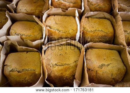 Breads in brown bag kept on display counter in supermarket