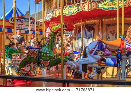 San Francisco, California, United States - August 14, 2016: Leisure, recreation and holidays concept. Funny children of popular Carousel at Fisherman's Wharf famous shopping center of Pier 39.