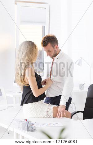 Employee Undressing Her Boss