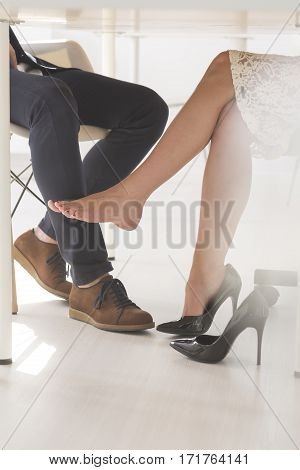 Woman Seductively Touching Man With Her Leg